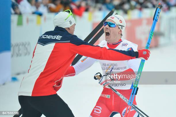 Members of Team Norway Niklas Dyrhaug and Finn Haagen Krogh celebrate after they win Men crosscountry 4 x 100km Relay Classic/Free final at FIS...
