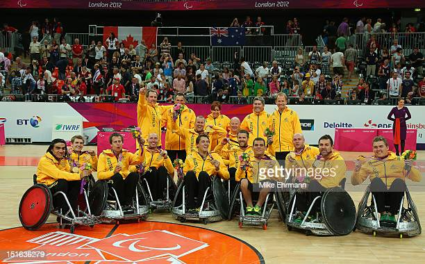 Members of team of Australia celebrate winning the Gold Medal match of Mixed Wheelchair Rugby against Canada on day 11 of the London 2012 Paralympic...