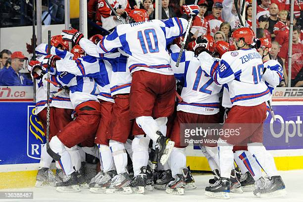 Members of Team Russia celebrate after defeating Team Canada during the 2012 World Junior Hockey Championship Semifinal game at the Saddledome on...