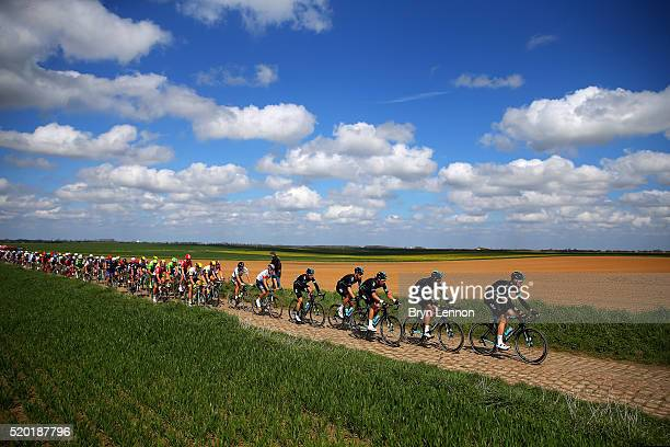 Members of Team Sky ride at the front of the peloton during the 2016 Paris Roubaix cycle race from Compiegne to Roubaix on April 10 2016 at an...
