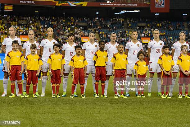 Members of team Spain lineup with the young field escorts during the 2015 FIFA Women's World Cup Group E match against Brazil at Olympic Stadium on...