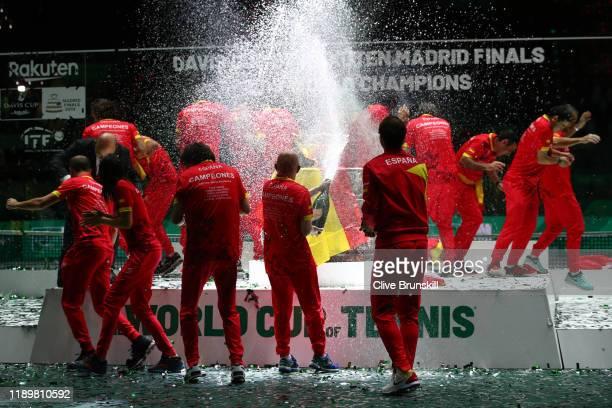 Members of team Spain spray cava at Marcel Granollers, Feliciano Lopez, Pablo Carreno Busta, Roberto Bautista Agut, Rafael Nadal and team captain...