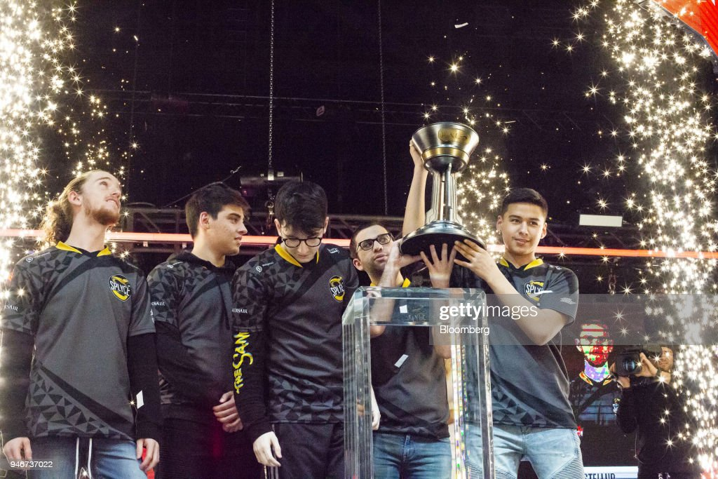Members of team Splyce, from left to right, Braedon Boettcher, Jonathan Willette, Kevin Smith, Jon Dadi, and Anthony Cuevas-Castro stand on stage while holding a trophy after winning the Halo World Championship finals in Seattle, Washington, U.S., on Sunday, April 15, 2018. E-sports revenue, consisting of merchandise, event tickets, sponsorships, advertising and media rights -- all beyond game sales -- is expected to rise at a 32.2% average annual rate in 2016-20 to $1.5 billion in 2020, according to Newzoo. Photographer: David Ryder/Bloomberg via Getty Images