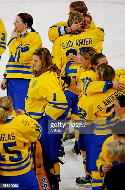 Members of team Sweden consol each other after falling to Canada 4-1 to take the silver medal in the final of the women's ice hockey during Day 10 of...