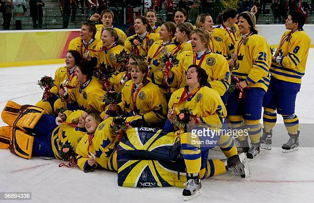 Members of team Sweden pose for a team picture after winning the silver medal after falling to Canada 4-1 in the final of the women's ice hockey...