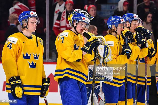 Members of Team Sweden react after losing in the bronze medal round to Team Russia during the 2017 IIHF World Junior Championship game at the Bell...