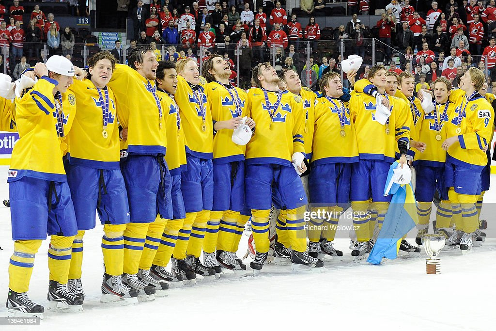 Members of Team Sweden sing the Swedish national anthem after defeating Team Russia in the 2012 World Junior Hockey Championship Gold Medal game at the Scotiabank Saddledome on January 5, 2012 in Calgary, Alberta, Canada. Team Sweden defeated Team Russia 1-0 in overtime.