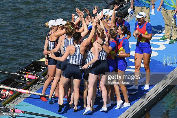 Members of Team United States celebrates winning the gold medals with members of Romania who won the bronze after the Women's Eight Final A on Day 8...