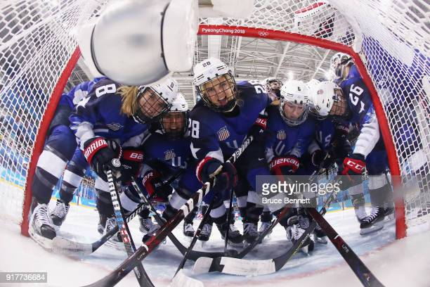 Members of Team United States pose in the goal before the Women's Ice Hockey Preliminary Round Group A game against Olympic Athletes from Russia on...