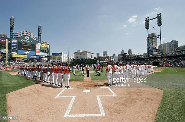 Members of Team USA and the World Team stand for the National Anthem before the Major League Baseball All-Star Futures Game at Comerica Park on July...