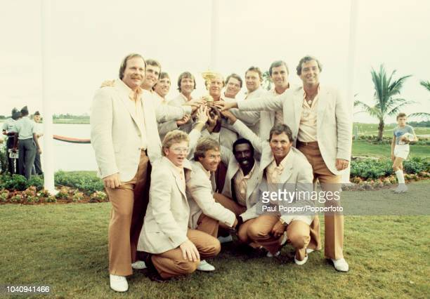 Members of Team USA celebrate with the Ryder Cup Trophy after beating Team Europe 145 135 to win the 1983 Ryder Cup matches at PGA National Golf Club...