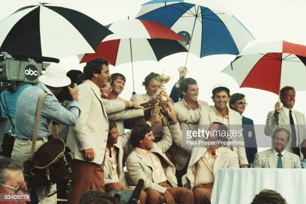 Members of Team USA celebrate with the Ryder Cup trophy after beating Team Europe 14.5 to 13.5 to win the 1983 Ryder Cup Matches at the PGA National...