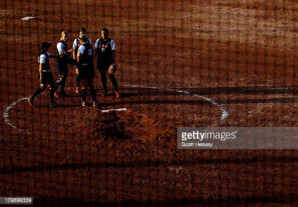 Members of team USA gather together during the Women's Softball Group 1 match between Argentina and the USA during the XVI Pan American Games Day...