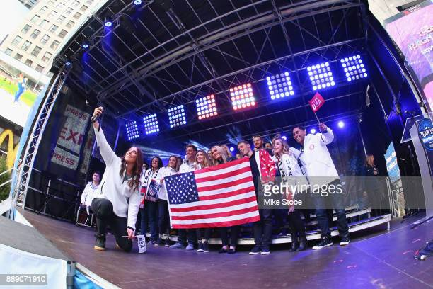 Members of Team USA pose for a photo during the 100 Days Out 2018 PyeongChang Winter Olympics Celebration Team USA in Times Square on November 1 2017...