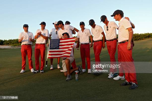 Members of Team USA pose for photos with a flag after defeating Team Great Britain and Ireland 14-12 during Sunday singles matches on Day Two of The...