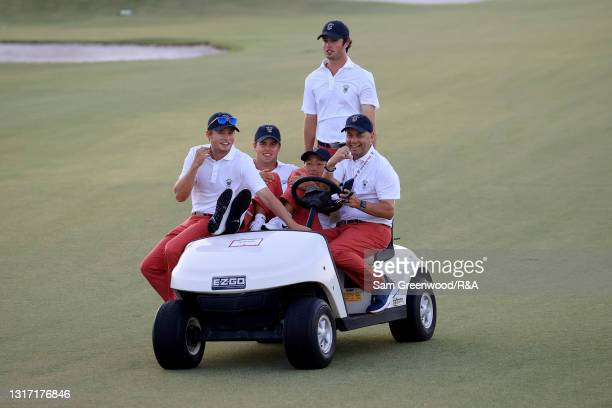 Members of Team USA ride a golf cart during Sunday singles matches on Day Two of The Walker Cup at Seminole Golf Club on May 09, 2021 in Juno Beach,...