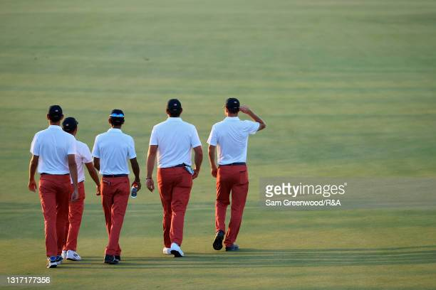 Members of Team USA walk across the course after defeating Team Great Britain and Ireland 14-12 during Sunday singles matches on Day Two of The...
