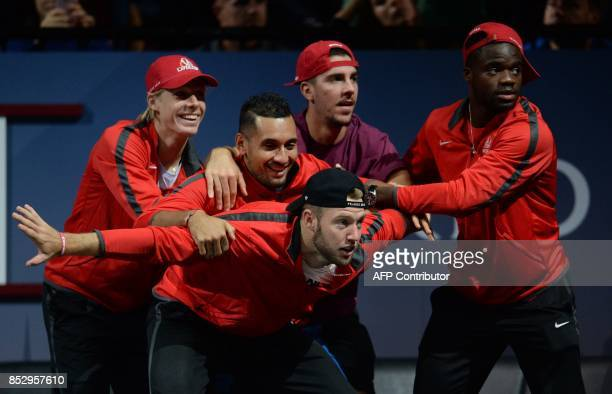 Members of Team World react during a match between US John Isner of Team World against Spanish Rafael Nadal of Team Europe during third day of Laver...