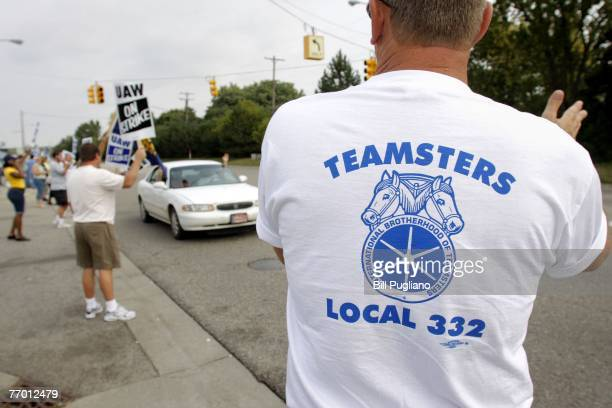 Members of Teamsters Local 332 in Flint watch over the picket line and show their support for members of the United Auto Workers as they strike in...