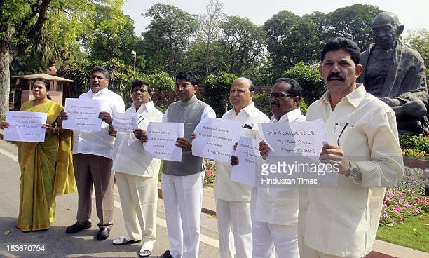 Members of Telugu Desam party held dharna as a protest demanding justice Illegal Babli irrigation project construction at parliament house during the...