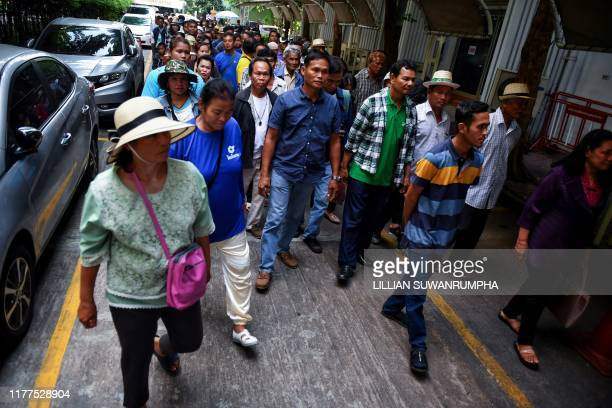 Members of Thai farmers group arrive at the Ministry of Industry in support of certain pesticides during a government committee hearing in Bangkok on...