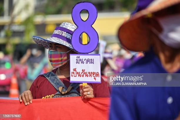 Members of Thai labour rights groups and state enterprise unions march for labour rights on International Womens Day in Bangkok on March 8, 2020.