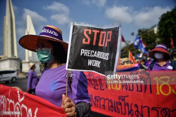Members of Thai labour rights groups and state enterprise unions march for labour rights in front of the Democracy Monument on International Womens...