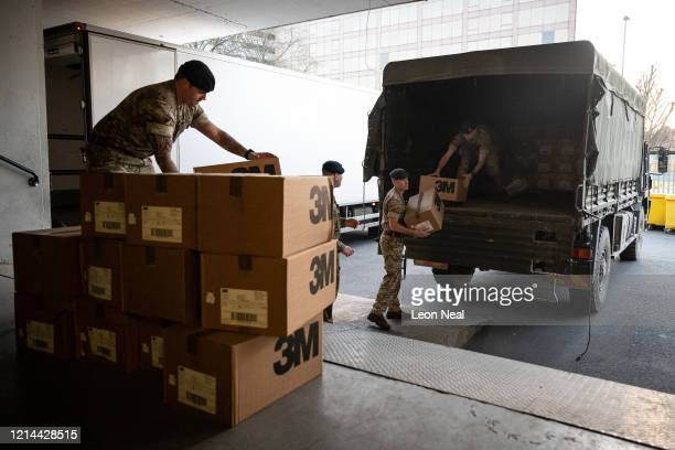 Members of the 101 Logistic Brigade of the British Army deliver a consignment of medical masks to St Thomas' hospital on March 24 2020 in London...