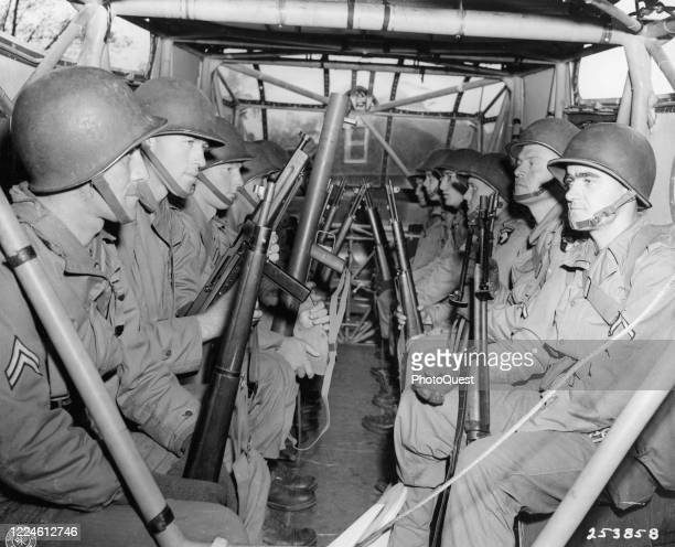 Members of the 101st Airborne Division sit in a glider as they await take off from RAF base Greenham Common during maneuvers in preparation for the...