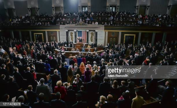 Members of the 103rd congress attend a joint session on the opening day of the current session. The members and their families mingle on the house...
