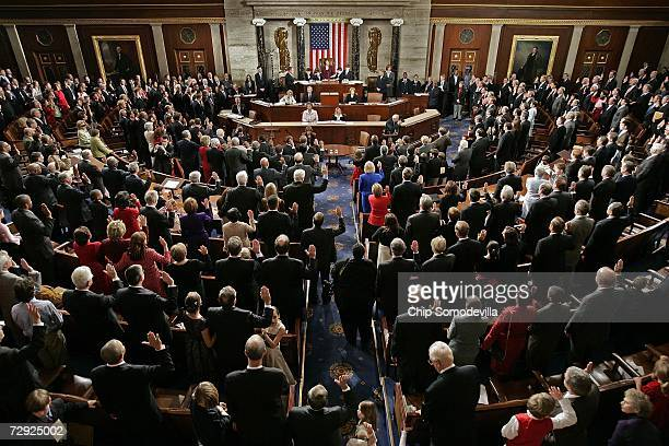 Members of the 110th Congress raise their right hands and take the oath of office during the swearing in ceremony in the House Chamber of the US...