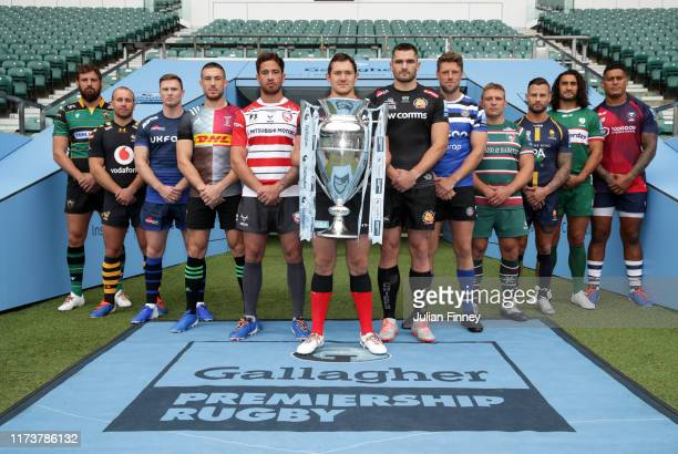 Members of the 12 Gallagher Premiership Rugby Sides pose for a photo from left to right Tom Wood of Northampton Saints Dan Robson of Wasps Chris...