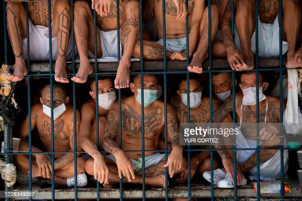 Members of the MS-13 and 18 gangs remain in an overcrowded cell at the Quezaltepeque prison, in Quezaltepeque, El Salvador, on September 4, 2020. -...