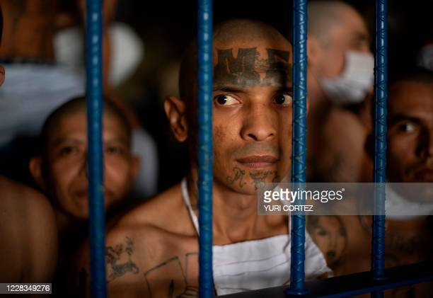 Members of the MS-13 and 18 gangs remain inside their cells during a visit by the Director of the General Directorate of Penal Centers, Osiris Luna ,...
