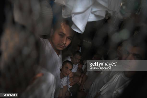 Members of the MS-13 gang accused of various crimes remain crammed in a cell at a jail of the National Civil Police in Ilopango, Salvador, on...