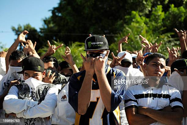 Members of the MS13 gang gesture during the official act to name the city of Ilopango a suburb of San Salvador as a peace district for gang members...