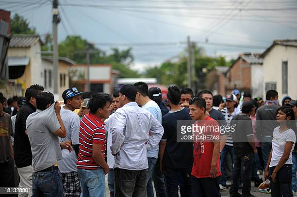 Members of the MS13 gang try to get away from the police as police investigators arrest one of them during a visit of participants in the Meeting of...