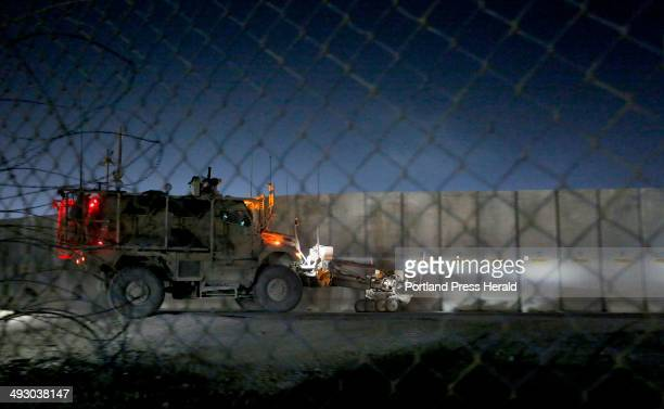 Members of the 133rd Engineer Battalion of the Maine Army National Guard depart a staging area at Bagram Air Field in a Mine Resistant Ambush...