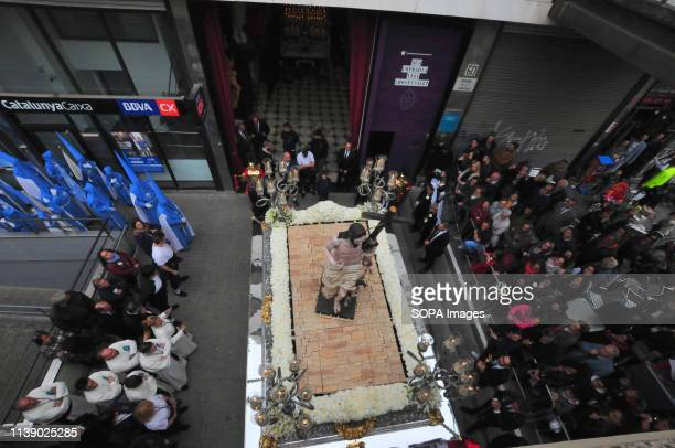 L´HOSPITALET CATALONIA SPAIN Members of the 15 1 Brotherhood seen carrying the religious image of the Virgin of the remedies during the parade Easter...