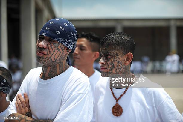 Members of the 18 street gang listen to a press conference at the yard of the jail in Izalco 60 km west of San Salvador El Salvador on May 20 2013...