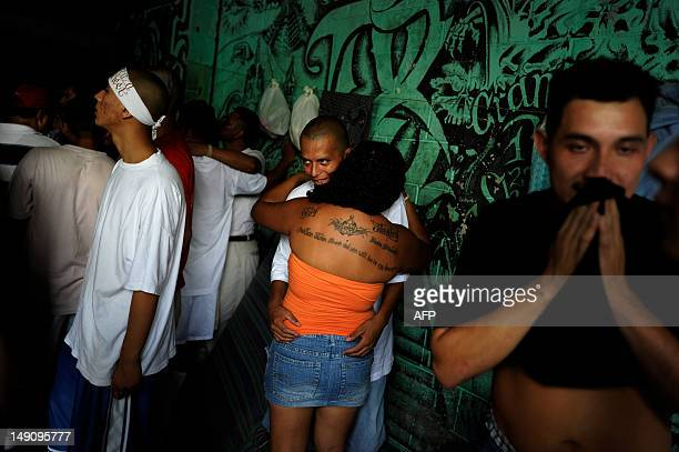 Members of the 18th street gang gather in the prison yard in the Quezaltepeque jail in the town of Quezaltepeque 25 kms west of San Salvador on July...