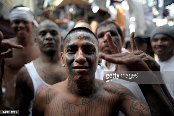 Members of the 18th street gang participate in a meeting to hear visiting speakers at the Cojutepeque Jail 30 kms east of San Salvador on July 24...