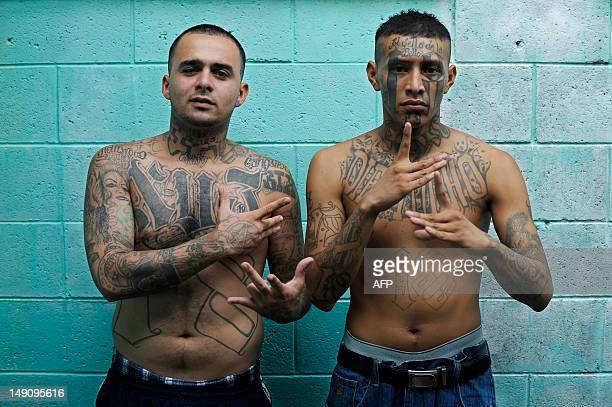 Members of the 18th street gang pose for a picture in the Quezaltepeque jail in the town of Quezaltepeque 25 kms west of San Salvador on July 22 2012...