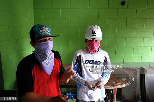 Members of the 18th street gang works in a gangoperated bakery as part of a rehabilitation program for gangsters during a visit of participants in...