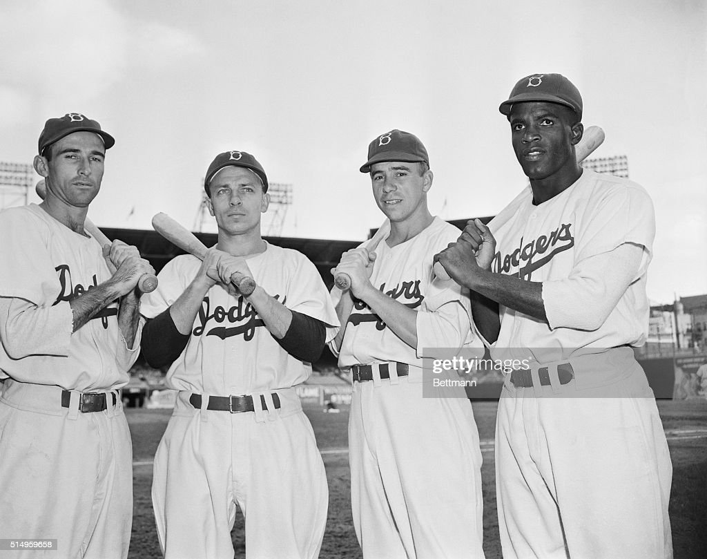 Members of the 1947 Brooklyn Dodgers are, L-R, Spider Jorgensen, Eddie Stanky, Pee Wee Reese, and Jackie Robinson. In 1947 Robinson made his debut with the Dodgers, becoming the first African American to play in the Major Leagues.