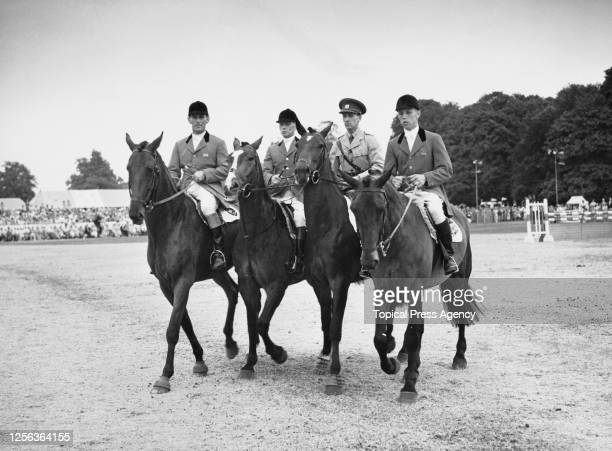 Members of the 1952 Great Britain Olympic showjumping team on horseback at the Royal Windsor Horse Show, held at Home Park in Windsor, Berkshire,...