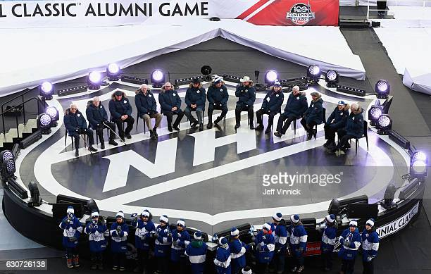Members of the 1967 Toronto Maple Leafs Stanley Cup team are acknowledged on stage during the 2017 Rogers NHL Centennial Classic Alumni Game between...