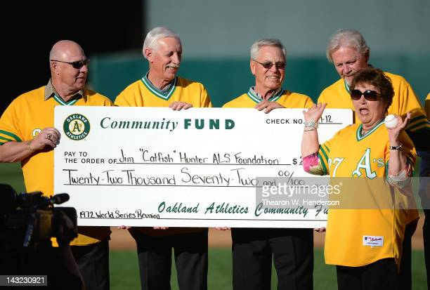 Members of the 1972 World Champions Oakland Athletics Gene Tenace Joe Rudy Dick Green and Dave Duncan presents a check in the amount of $22072 for...