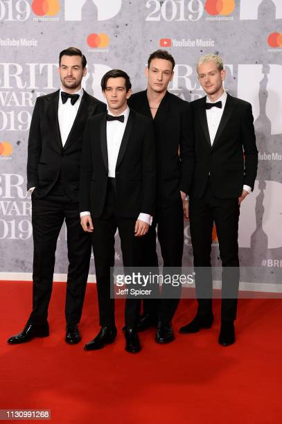 Members of 'The 1975' Matthew Healy Ross MacDonald George Daniel and Adam Hann attends The BRIT Awards 2019 held at The O2 Arena on February 20 2019...