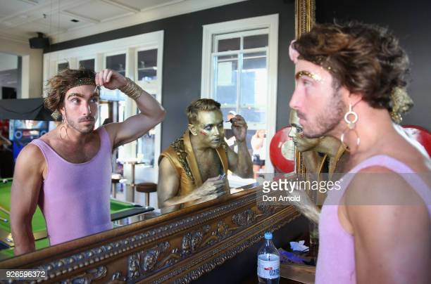 Members of the 1978 discothemed GlamCocks apply finishing touches at the Beauchamp Hotel just prior to the 2018 Sydney Gay Lesbian Mardi Gras Parade...